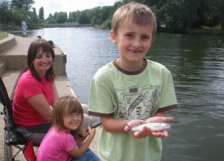 Family fishing on the River Thames in Reading