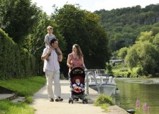 A family walking along the River Thames at Goring
