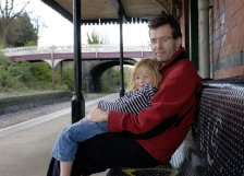 A dad and daughter waiting for the train