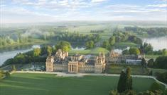 An aerial view across the South Lawn towards Blenheim Palace with the Great Lake behind